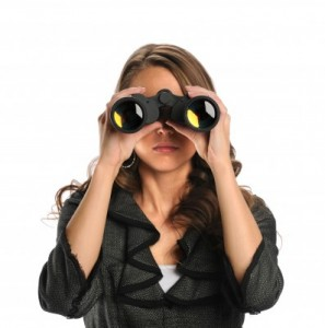 Image of woman looking into the future with binoculars