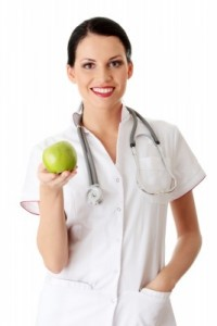 Woman Doctor offering a Green Apple for CFS